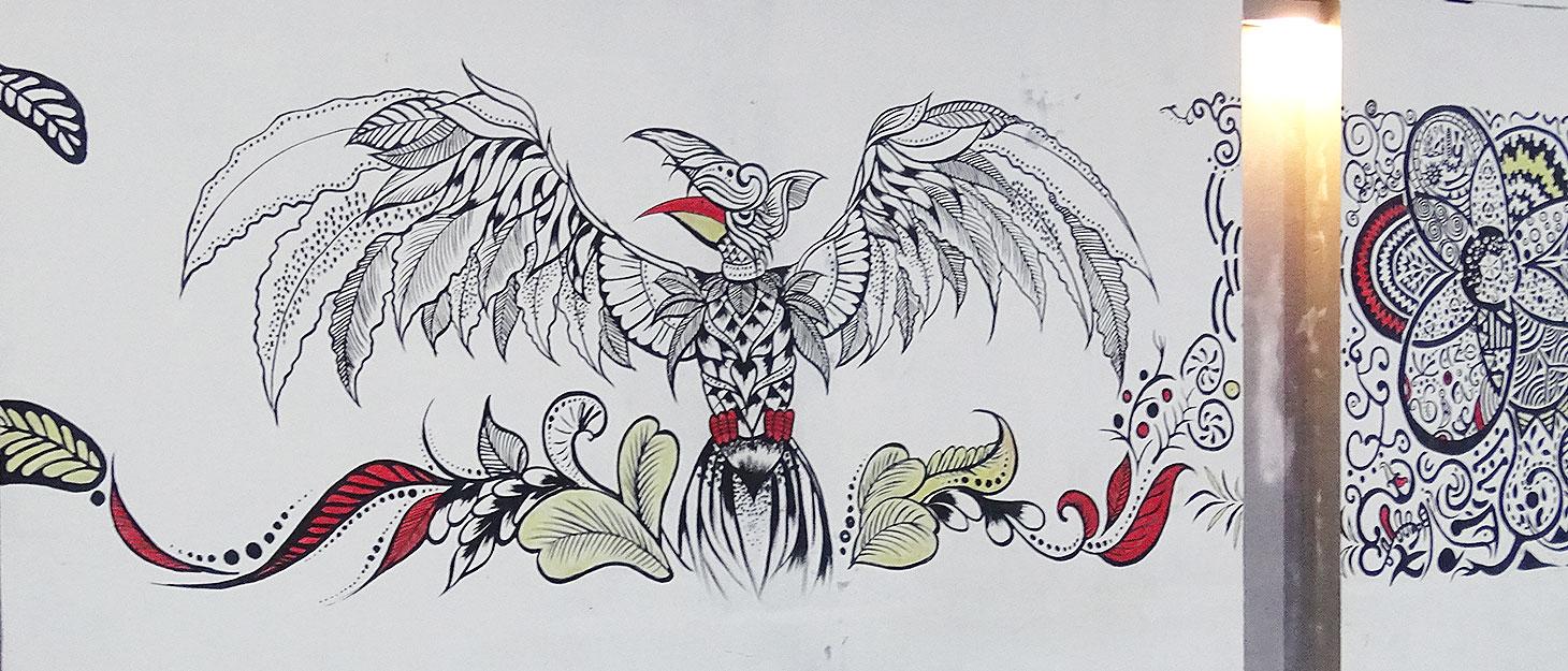 Zeichnung von Vogel an einer Wand
