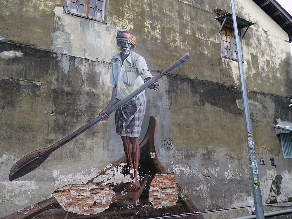 Mann auf Boot als Wandmalerei